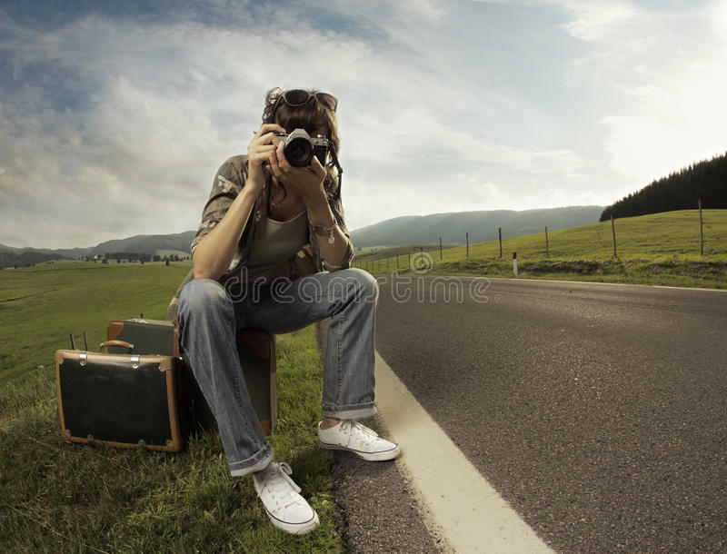Travel. A woman photographer on the side of the road.Copy space stock photos