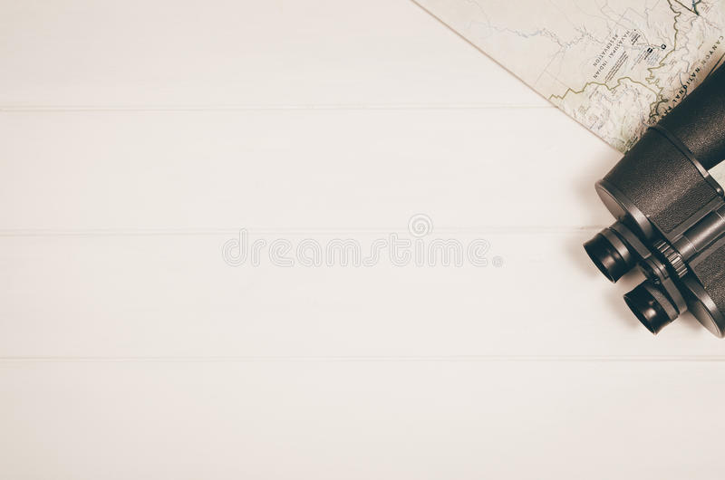 Travel accessories top view on wooden background with copy space royalty free stock photo