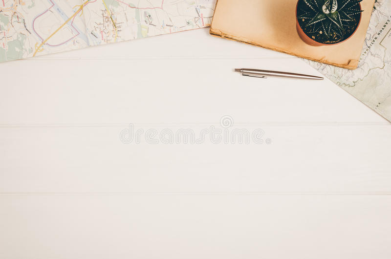 Travel accessories top view on wooden background with copy space stock photos