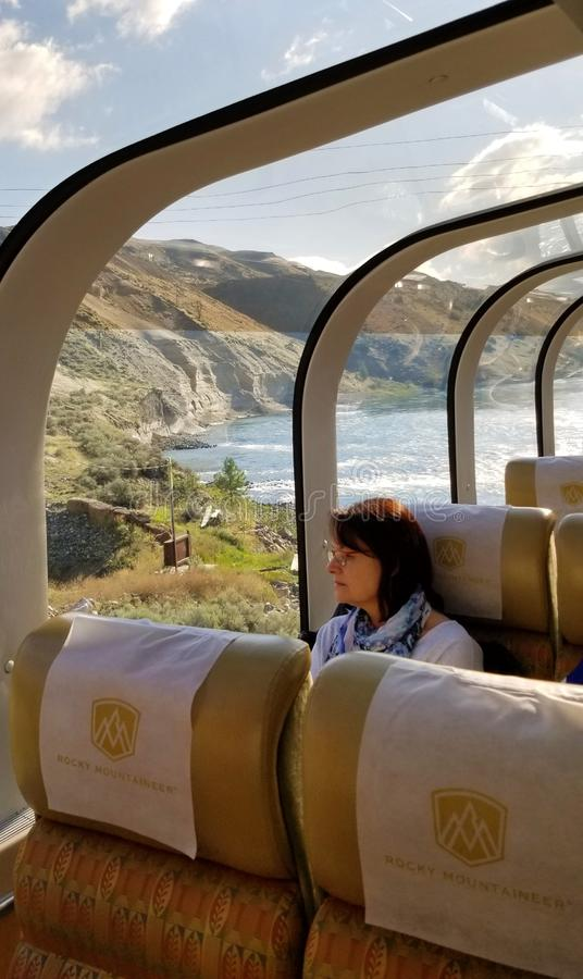 Travel across Canada by train for stunning views of Canadian Rocky Mountains. Summer in British Columbia. On the board of Rocky Mountaineer royalty free stock images