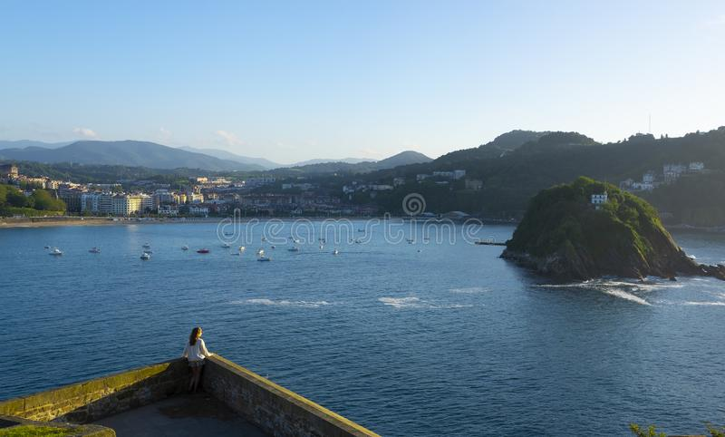 Travel and active lifestyle concept, Traveler woman looking on a big city of San Sebastian stock image