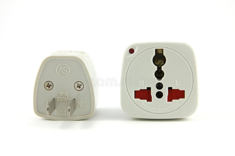 Travel adaptor. In isolated white royalty free stock photo