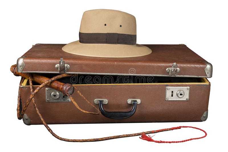 Travel and adventure concept. Vintage brown suitcase with fedora hat and bullwhip isolated on white royalty free stock images