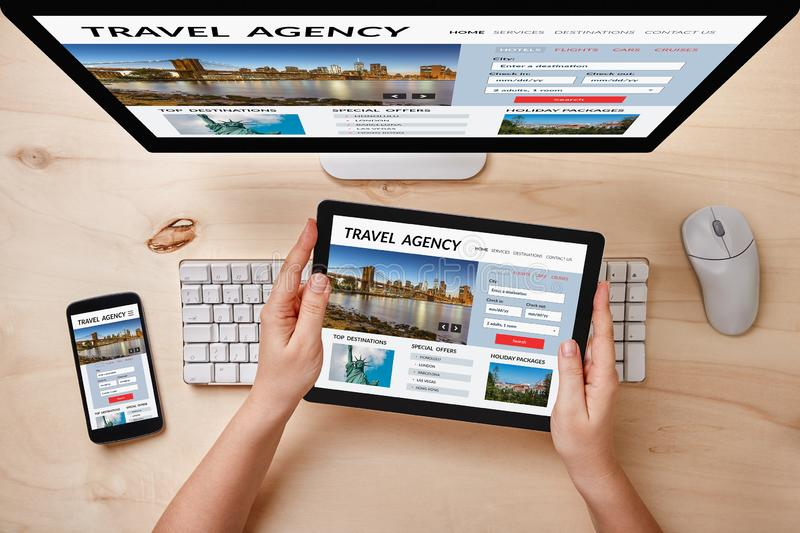 Travel agency concept on responsive devices stock photography