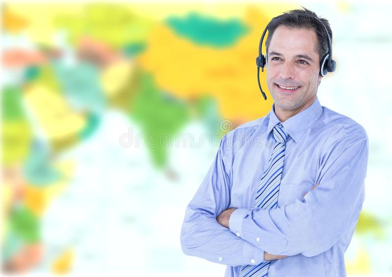 Travel agent man wearing headset in front of world map stock image