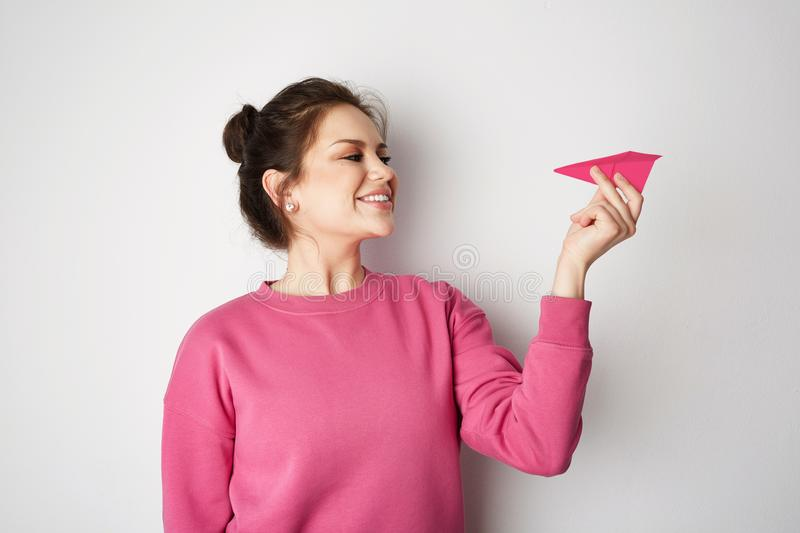 Download Travel Air Plane Concept.Young Smiling Girl Holding Hand Model Pink Paper Air Plane. Emotions, People, Beauty, Fashion Stock Image - Image of blue, origami: 118092047