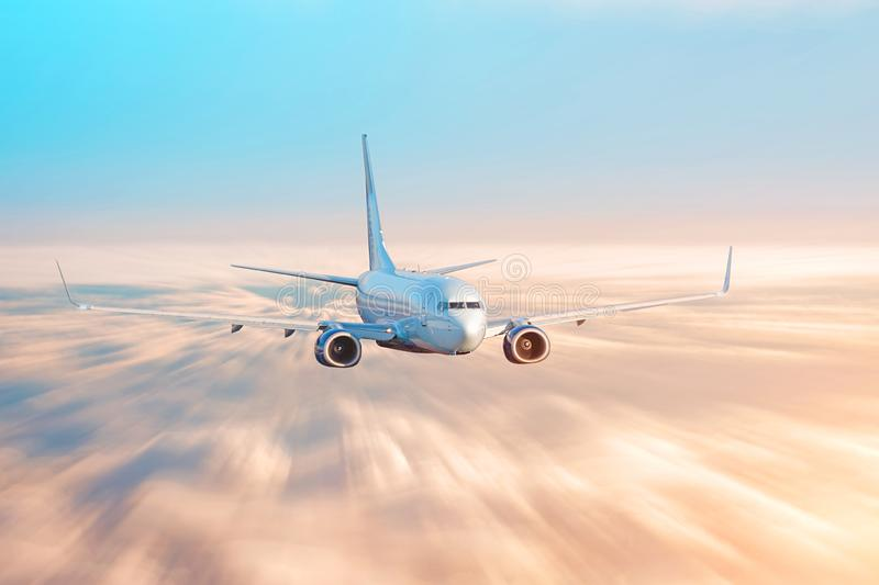 Travel by airplane, flight over the clouds evening sky sunset light.  royalty free stock image