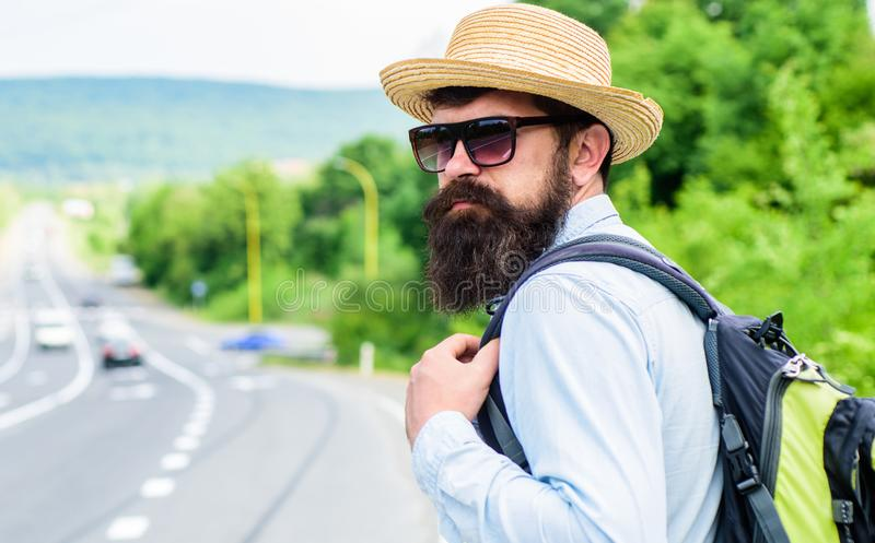 Travel alone. Hitchhiking means transportation gained asking strangers for ride in their car. Hitchhiker travel alone. Try stop transport to get to destination stock photo