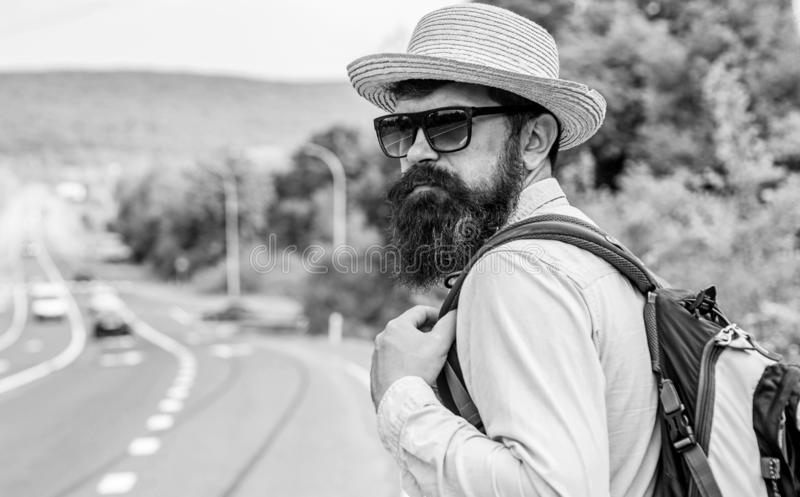 Travel alone. Hitchhiking means transportation gained asking strangers for ride in their car. Hitchhiker travel alone royalty free stock photos