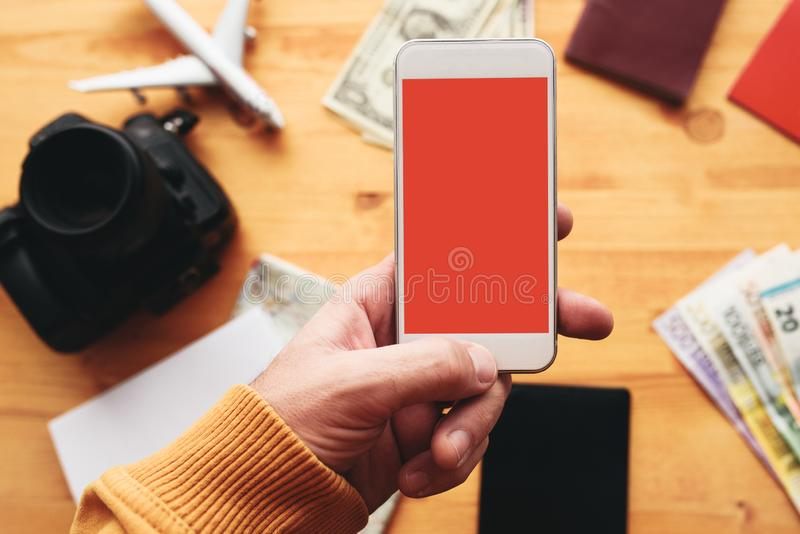 Travel app for mobile phone mock up screen stock photo