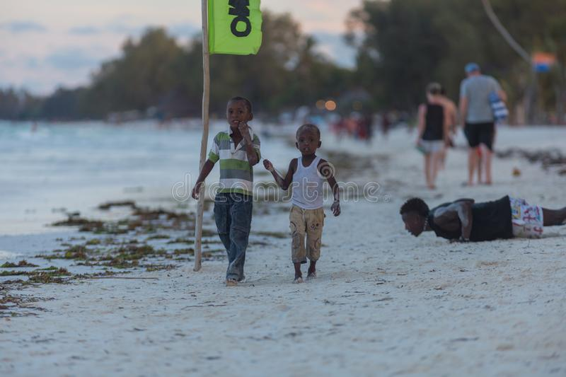 Travel around Tanzania. Group of ethnic people playing on the beach. 2018.02.21, Kiwengwa, Tanzania. Travel around Tanzania. Group of ethnic people playing on stock photo