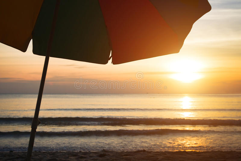 Travel background with beach umbrella stock photos