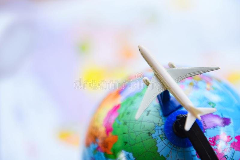Travel background concept - Airplane Traveler`s fly Airlines worldwide with plane on on world globe royalty free stock image