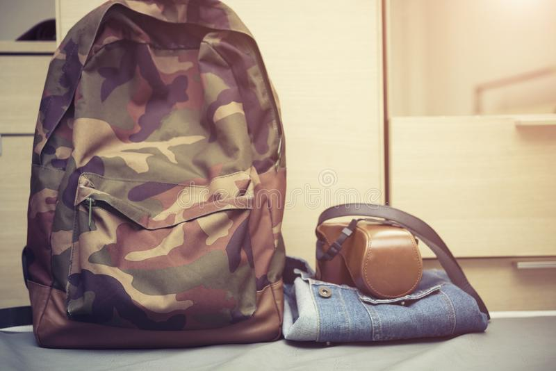 Travel background concept, hipster bag with retro camera case on stock images