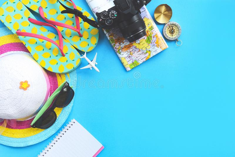 Travel background concept / Planning Essential vacation trip items summer travel accessories with camera sunglasses hat flip flops royalty free stock image