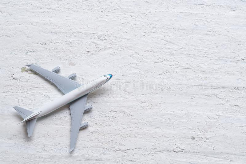Travel background concept. Top view of airplane model decor on r royalty free stock photography