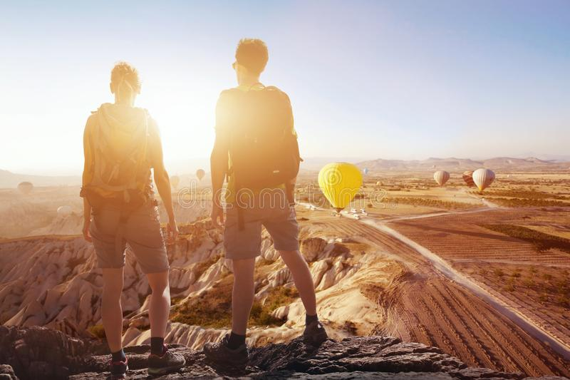 Travel background, couple of travelers looking at the panoramic spectacular beautiful view of mountains stock photos