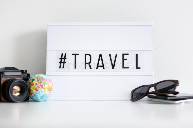 Retro light box with travel hash tag and travel objects. Travel background - retro light box with travel hash tag and travel objects royalty free stock photos