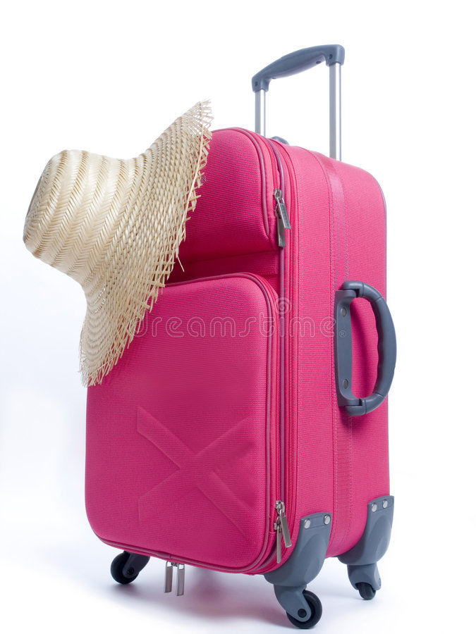 Travel bag and straw hat stock photos