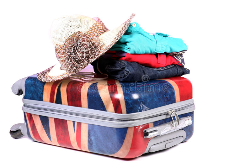 Travel baggage and clothes. Beautiful shot of travel baggage and clothes on white background stock photos