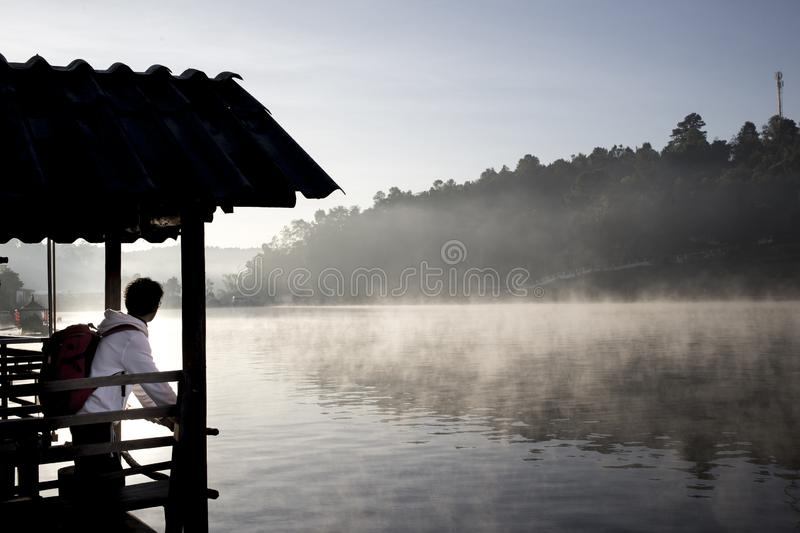 Travel Ban Ruk Thai village, Mae Hong Son province with beautiful mist over lake stock photo