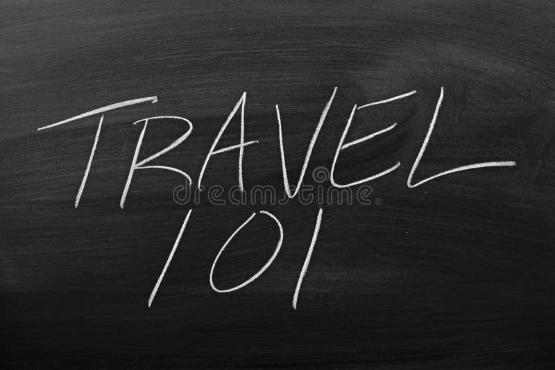 Travel 101 On A Blackboard. The words `Travel 101` on a blackboard in chalk royalty free stock photo