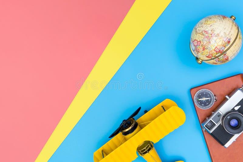 Travel blogger writer accessories flatlay on blue yellow. Hipster travel blogger writer accessories flatlay on blue yellow and pink royalty free stock photos