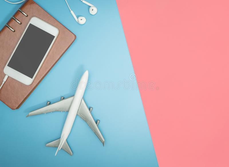 Travel blogger writer accessories flatlay on blue yellow and pink. Hipster travel blogger writer accessories flatlay on blue yellow and pink royalty free stock photography