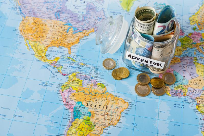 Travel budget concept money saved for vacation in glass jar on map money saved for vacation in glass jar on world map background copy space banknotes and coins for big adventure gumiabroncs Choice Image