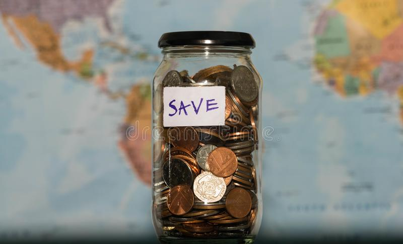 Travel budget concept money saved for vacation in glass jar on download travel budget concept money saved for vacation in glass jar on world map background gumiabroncs Gallery