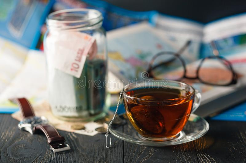 Travel budget concept. Travel money savings in a glass jar stock images