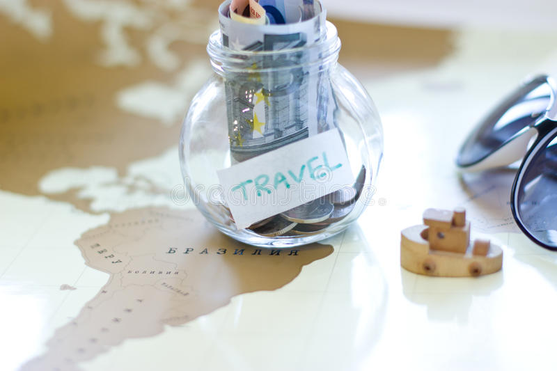 Travel budget vacation money savings in a glass jar on world map download travel budget vacation money savings in a glass jar on world map stock gumiabroncs Gallery