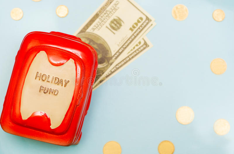 Travel budget - vacation money savings in money box. Collecting money for travel royalty free stock images