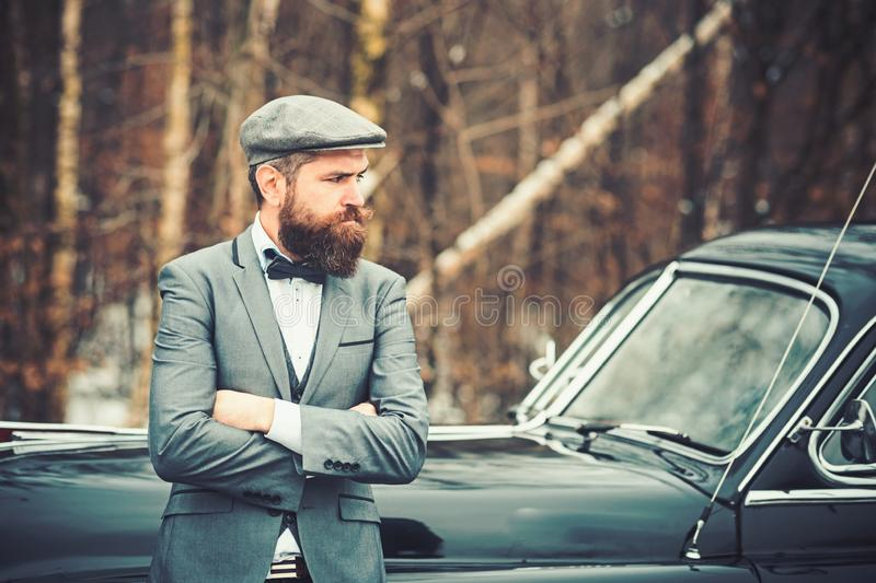 Travel and business trip or hitch hiking. Retro collection car and auto repair by mechanic driver. Call boy in vintage stock photography