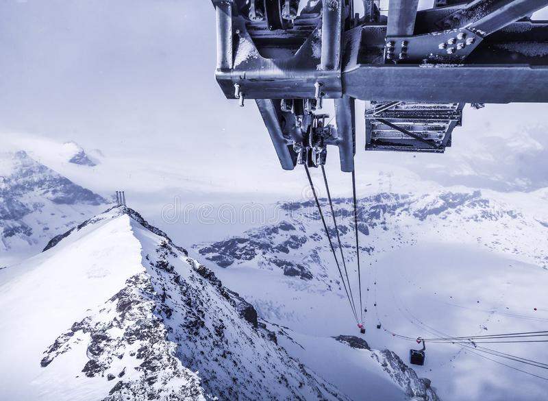 Travel by cable car to the top of the Swiss mountains. Exlusive view stock image
