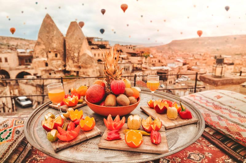 Travel in Cappadocia Colorful hot air balloons flying over the valley sunrise time with .special breakfast travel destination in. Turkey royalty free stock photography