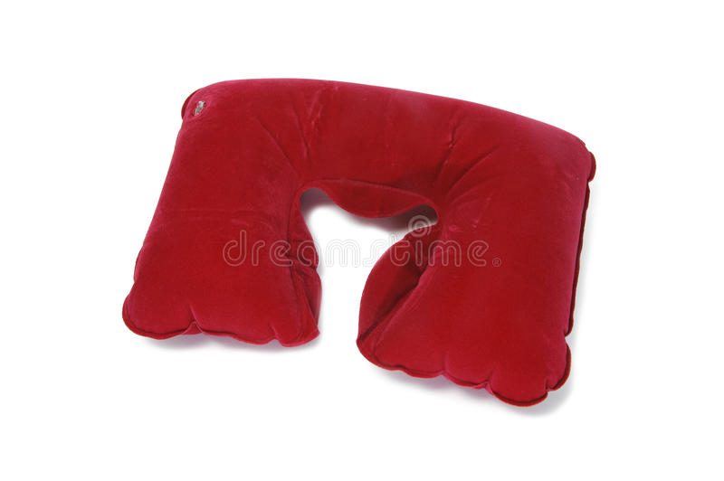 Travel cervical pillow. An inflatable travel cervical pillow isolated on a white background royalty free stock photos