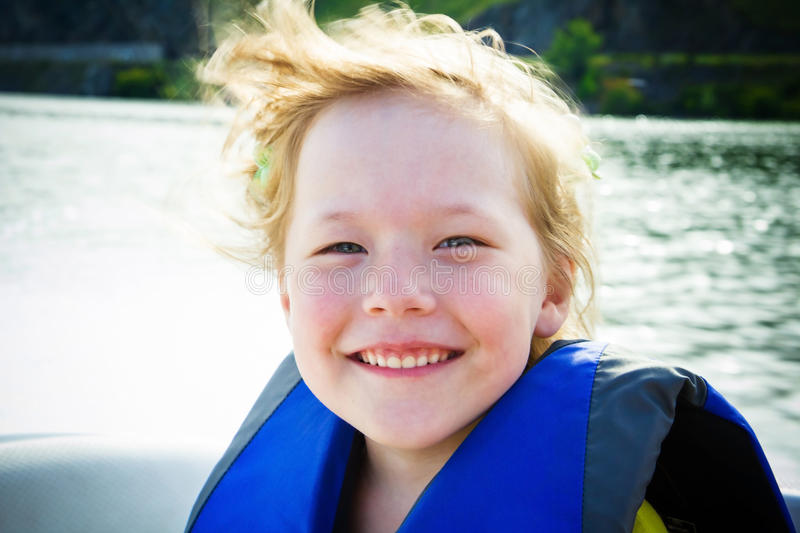 Travel of children on water in the boat stock photos