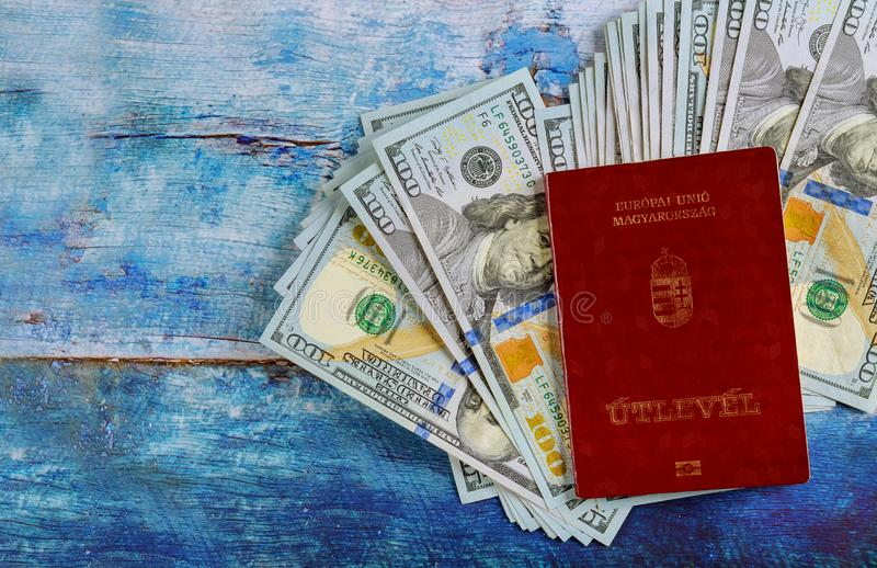 The Hungarian citizenship passports with travel in the money banknotes of one hundred dollars royalty free stock photo