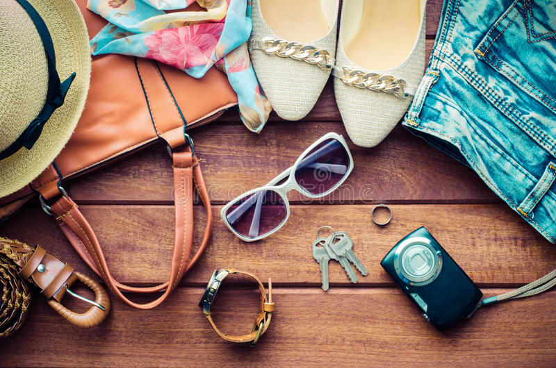Travel Clothing accessories apparel along for women on wood. royalty free stock images