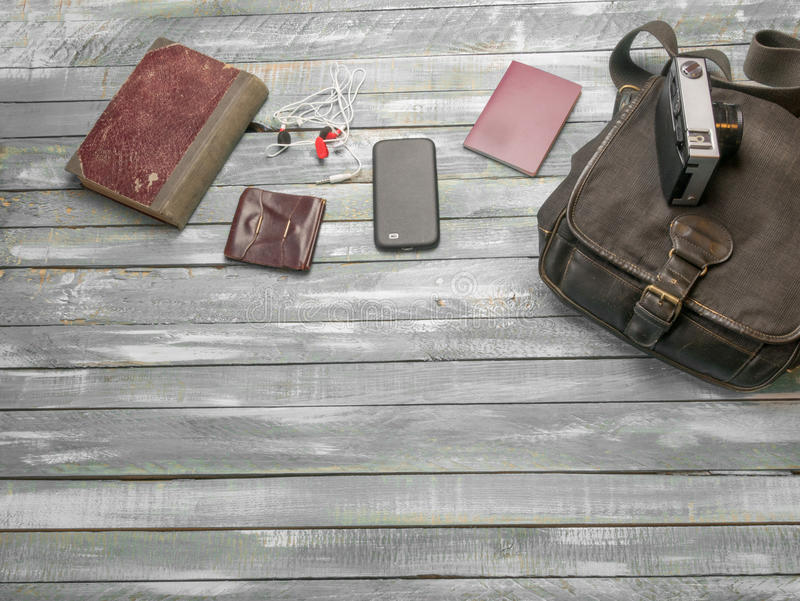 Travel Clothing man's accessories apparel along on wooden floor. Travel concept. Accessories for men on the vintage wooden floor royalty free stock photos