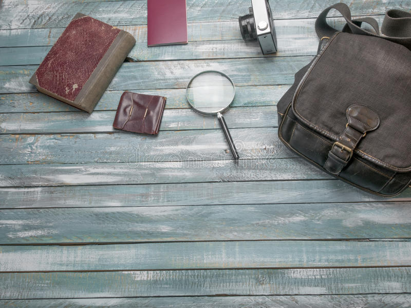 Travel Clothing man's accessories apparel along on wooden floor. Travel concept. Accessories for men on the vintage wooden floor royalty free stock images