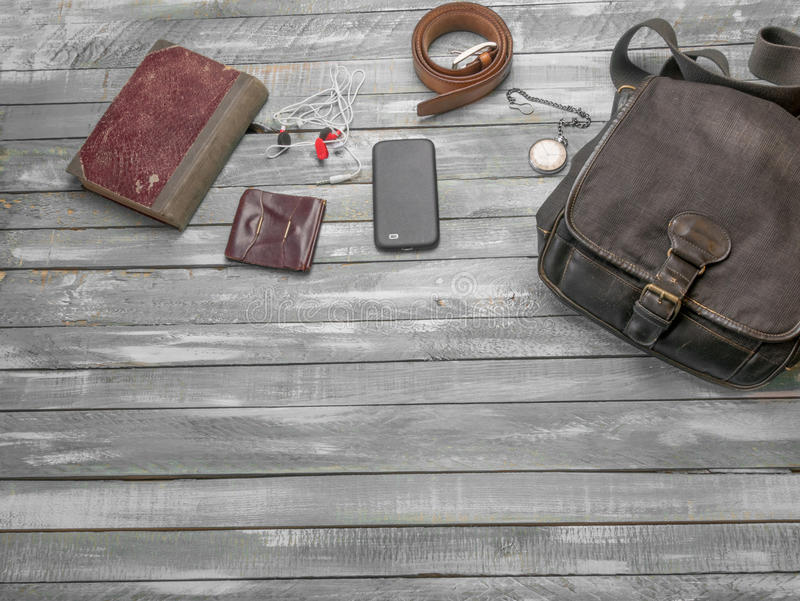 Travel Clothing man's accessories apparel along on wooden floor. Travel concept. Accessories for men on the vintage wooden floor stock photo