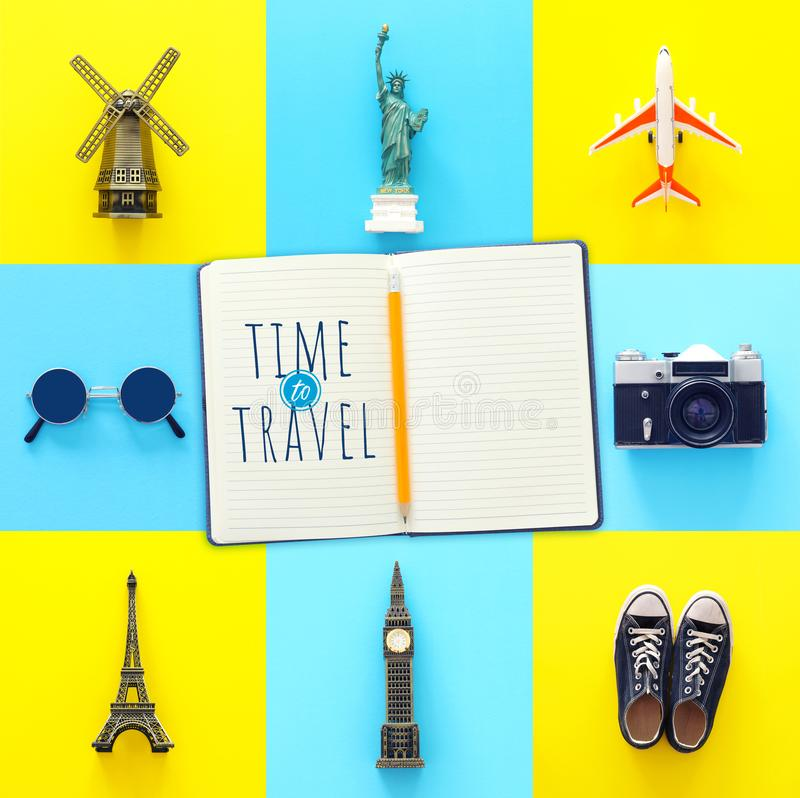 Travel collage concept with world symbols and icons. Top view royalty free stock photos