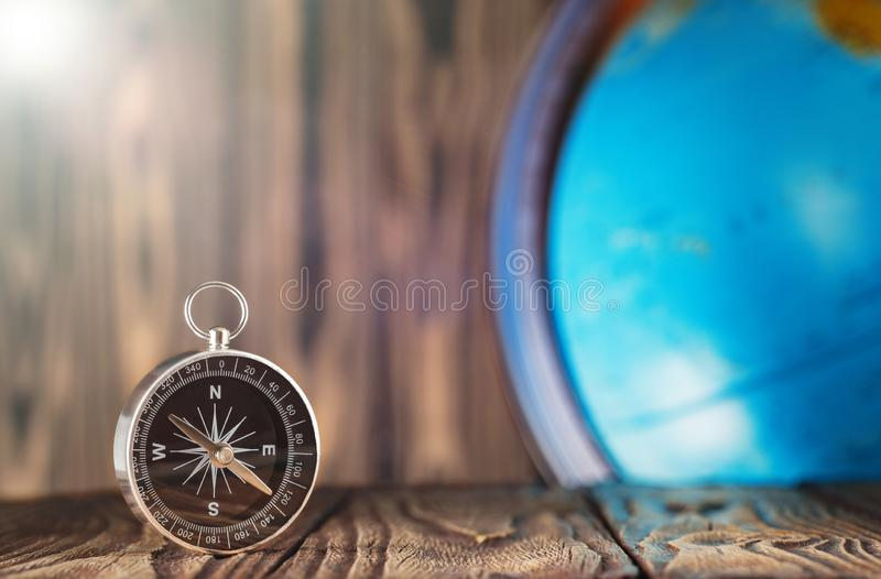 Travel compass and earth globus on wooden background. Journey, adventure lifestyle.Road to home.Trip. Travel compass and earth globus on wooden background royalty free stock photo