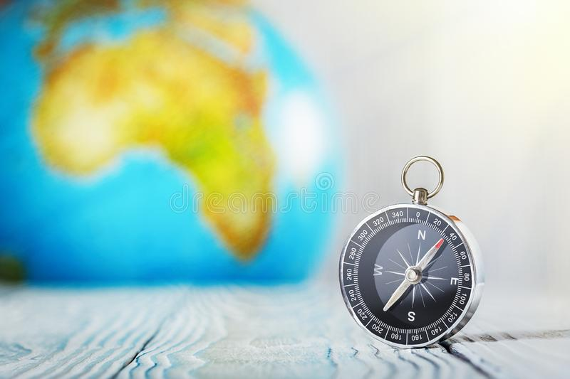 Travel compass and earth globus on wooden background. Journey, adventure lifestyle.Road to home.Trip. Travel compass and earth globus on wooden background stock images