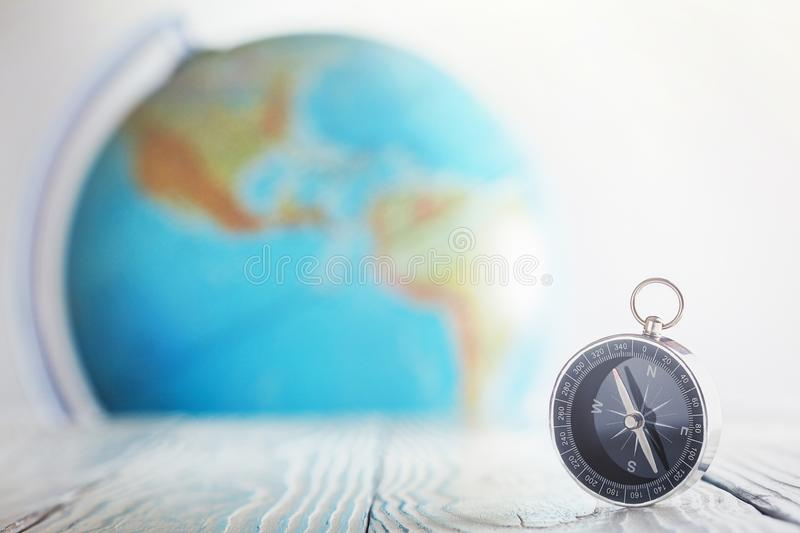 Travel compass and earth globus on wooden background. Journey, adventure lifestyle.Road to home.Trip. Travel compass and earth globus on wooden background royalty free stock image