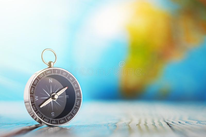 Travel compass and earth globus on wooden background. Journey, adventure lifestyle.Road to home.Trip. Travel compass and earth globus on wooden background stock image