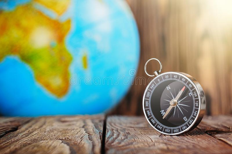 Travel compass and earth globus on wooden background. Journey, adventure lifestyle.Road to home.Trip. Travel compass and earth globus on wooden background stock photos
