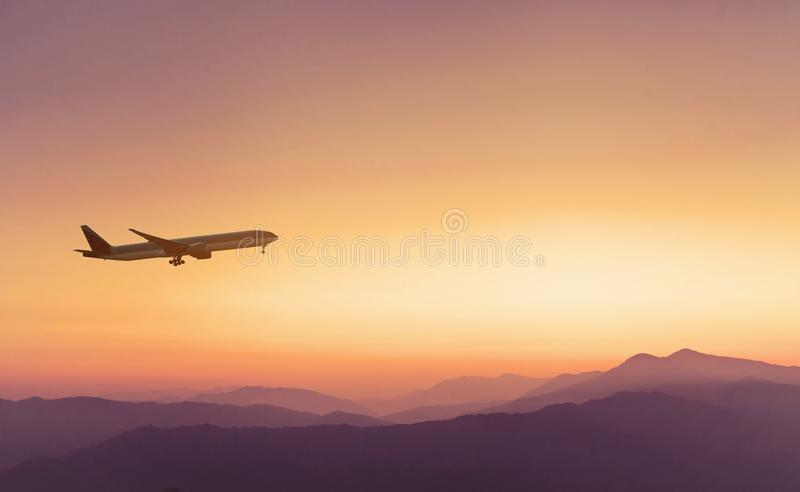 Travel concept background, airplane in sunset sky stock images